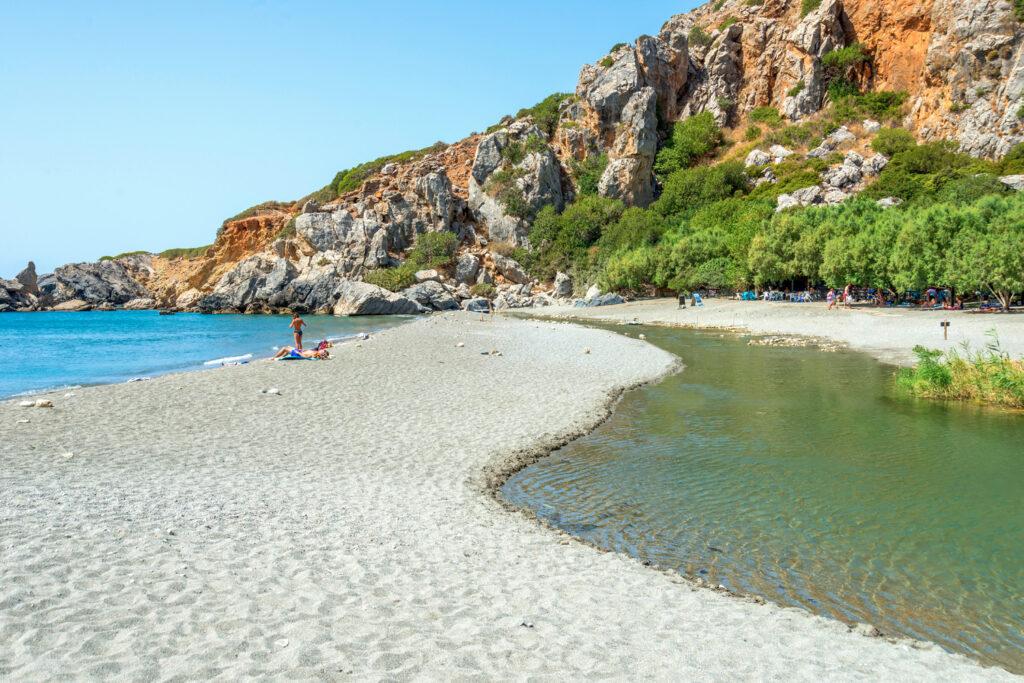 People enjoying Preveli beach in Crete, Greece