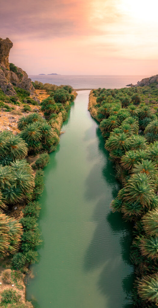 Panorama of Preveli beach at Libyan sea, river and palm forest, southern Crete , Greece