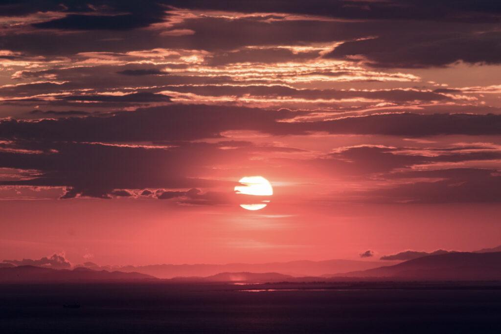 Beautiful red sunset in Patras, Peloponnese Western Greece - Photo by Jason Blackeye