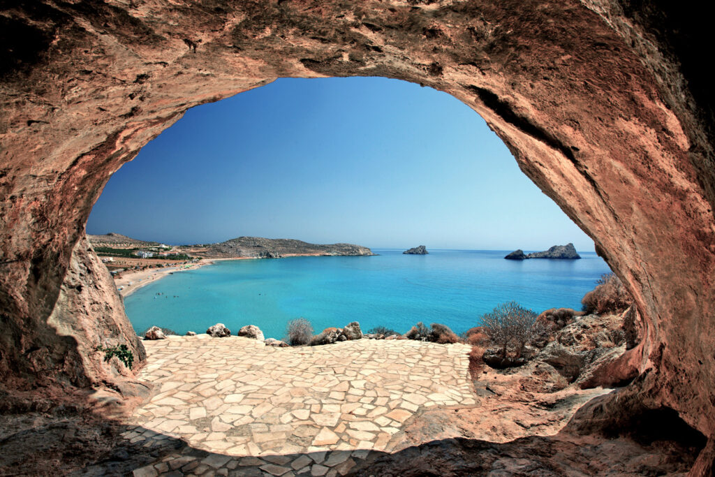 """""""Through"""" the cave you can see one of the many beautiful beaches at Xerokambos, Sitia, Lasithi, Crete, Greece"""