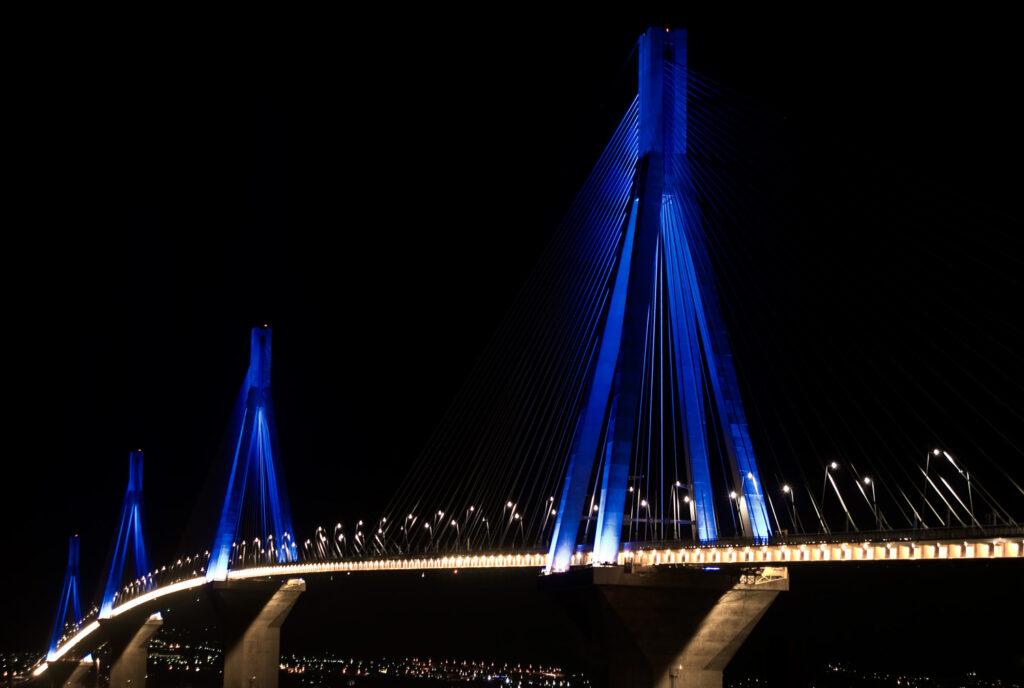 Rio-Antirio bridge connecting mainland Greece with Peloponnese above the Corinthian Gulf, illuminated at night