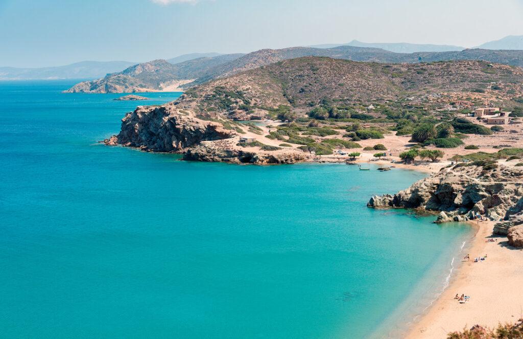 Sandy beach and clear blue water at lagoon of Crete island near Sitia town, Greece