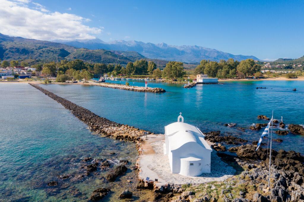 Small white chapel of Saint Nikolaos in the sea, Georgioupoli, Crete, Greece.