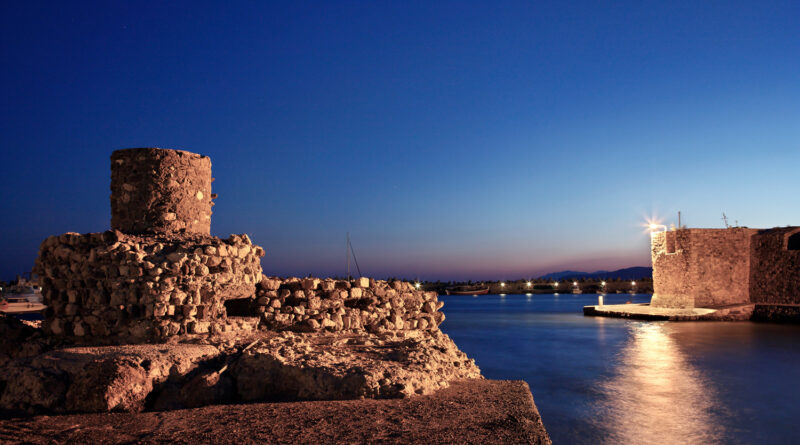 The entrance of the-old harbor of Ierapetra in Crete, Greece. To the-left ruins of an old lighthouse to the right the Venetian castle called Kales