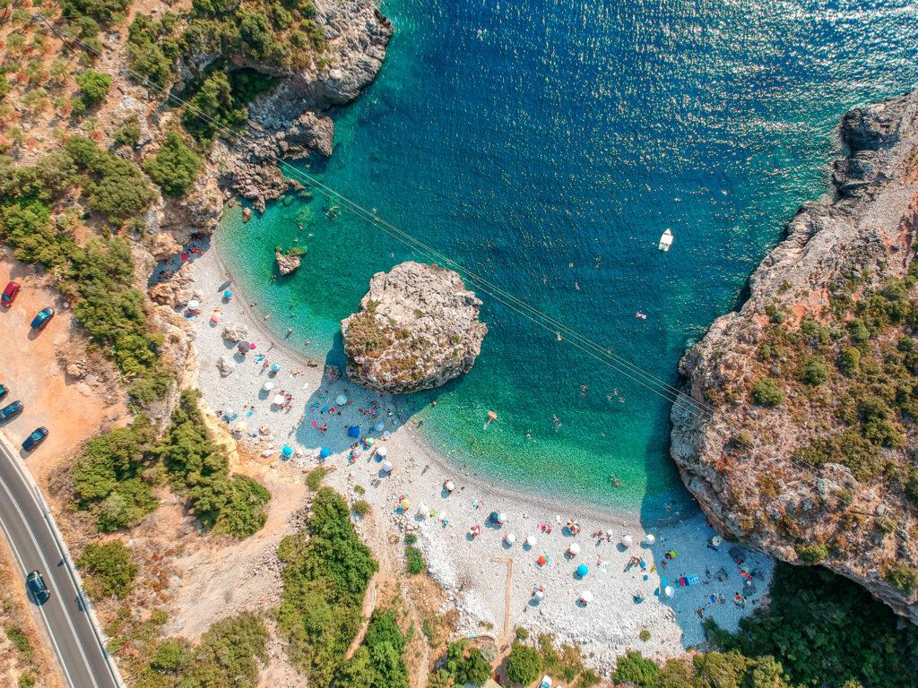 Aerial view of the rocky Foneas beach near Kardamyli village in seaside Mani, Peloponnese Greece