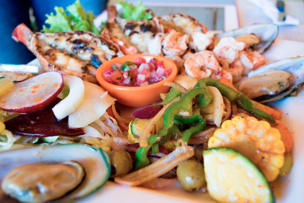 Delicious sea food plate with lobster, fish, and shrimp, taverna in Mani peninsula, Greece