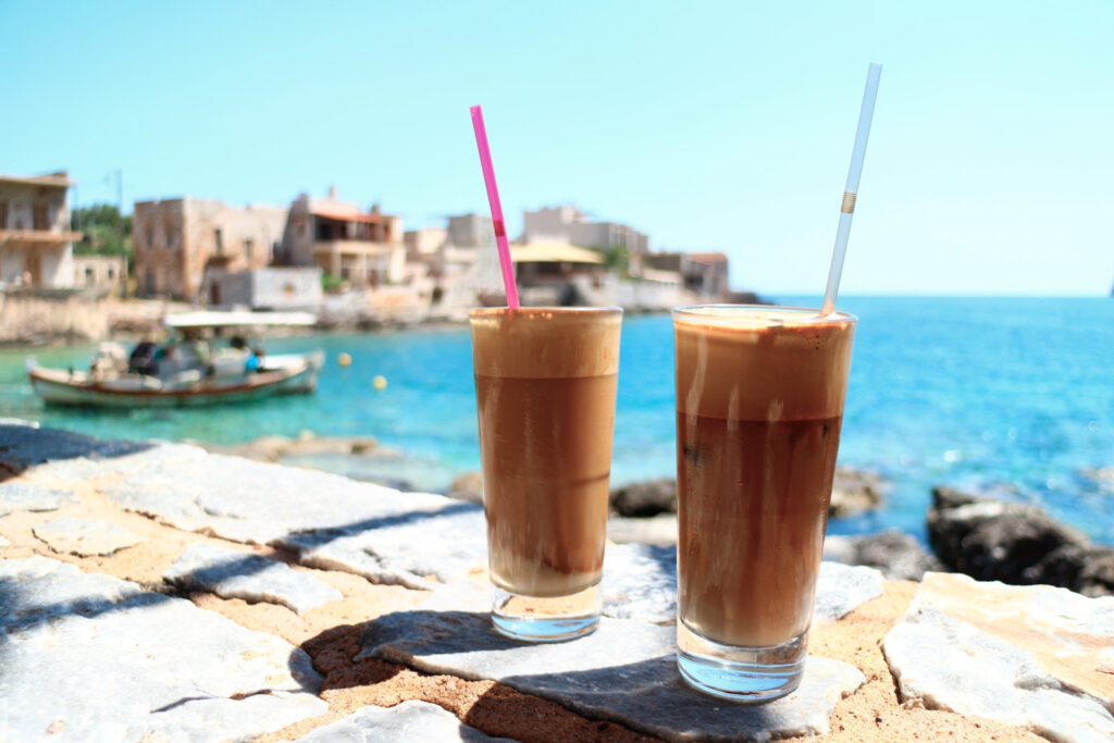 Two glasses og Greek frappé ice-coffee on the waterfront of Gerolimenas, Mani peninsula, Peloponnese Greece
