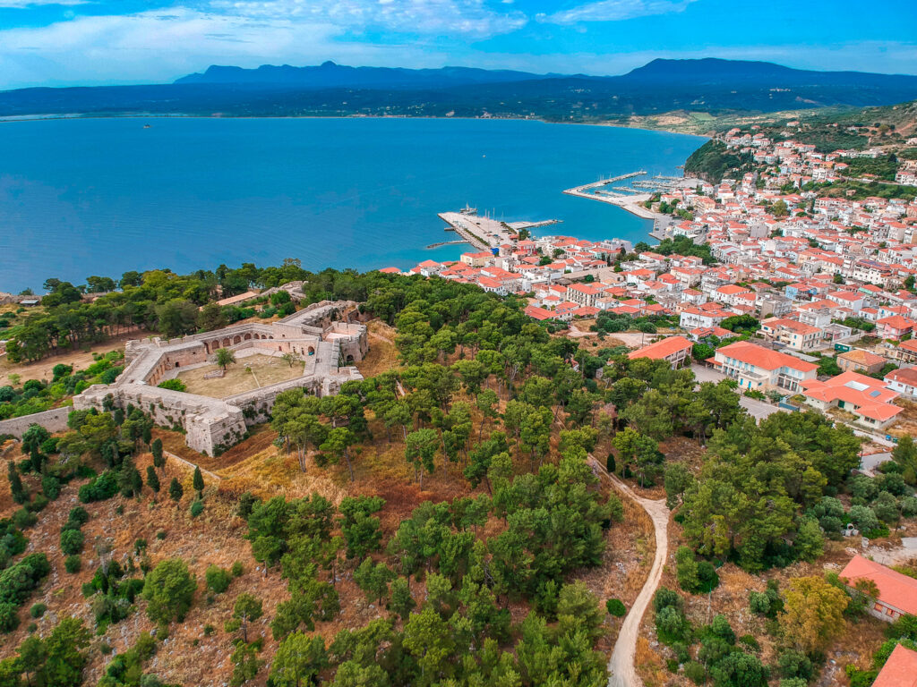 Aerial view of Pylos city and castle. It is one of the best preserved castles in Greece. New Navarino or Niokastro, located near the entrance of the port of Pylos. Messenia, Greece