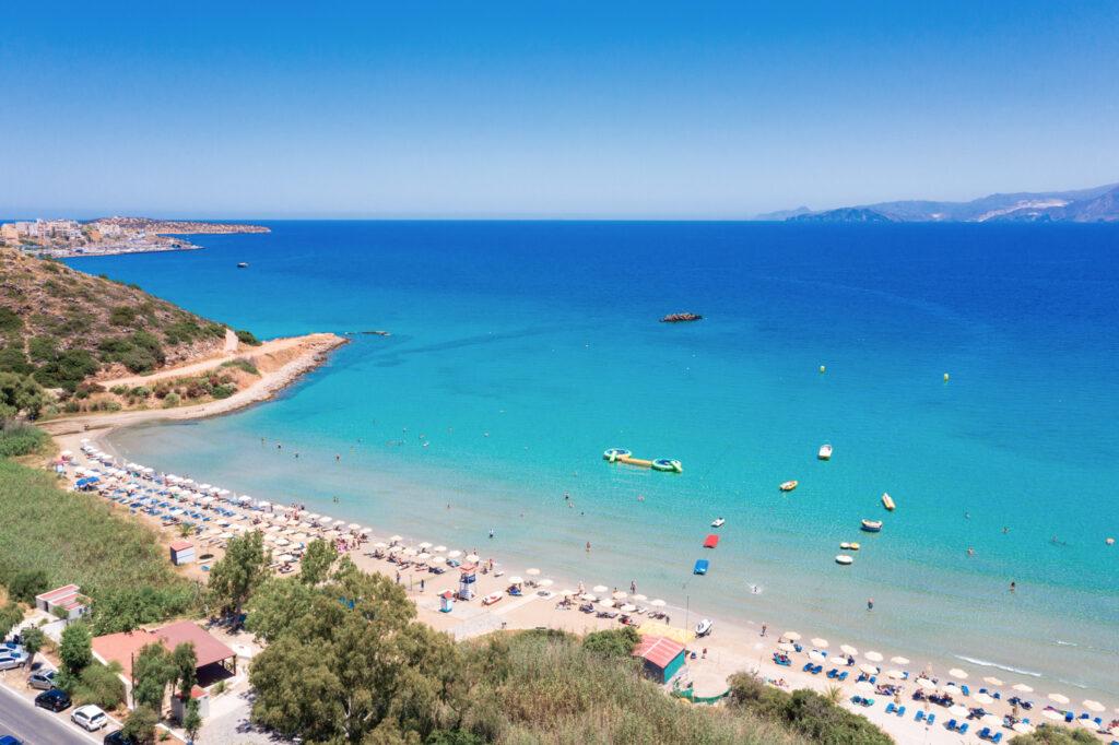 Famous sandy beach of Almyros and the river near Agios Nikolaos, Crete, Greece.