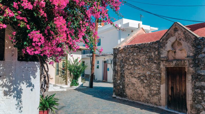 Kritsa traditional Cetan village with stone built church, narrow alleys and houses with bougainvilleas, near Agios Nikolaos. Crete, Greece
