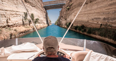 Passing through the Corinth Canal by yacht, Greece. The Corinth Canal connects the Gulf of Corinth with the Saronic Gulf in the Aegean Sea