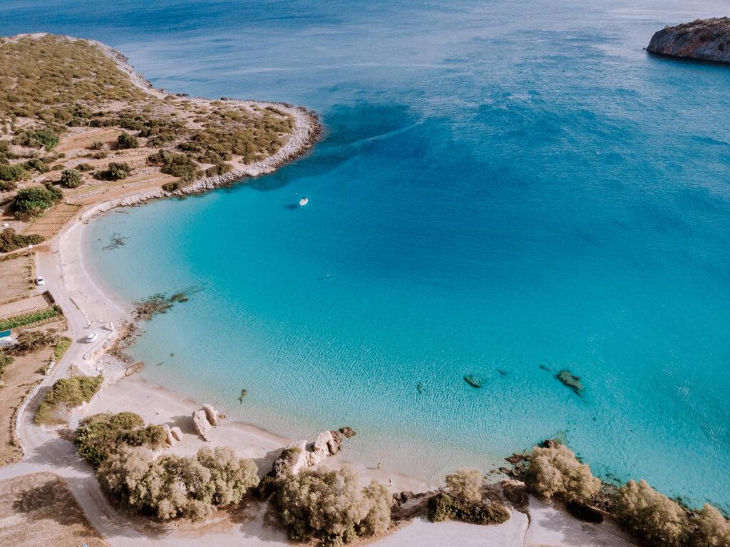 Tropical beach of Voulisma beach, Istron, Crete, Greece ,Most beautiful beaches of Crete island -Istron bay near Agios Nikolaos young couple mid age on vacation in Greece Crete