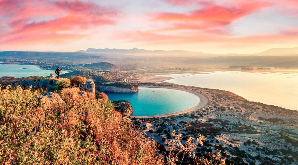 Voidokilia beach as seen from Navarino Castle. Great sunrise on the Ionian Sea, Pylos town, Messinia Greece