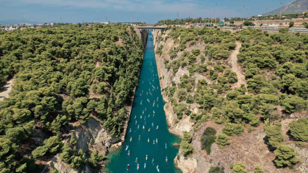 Aerial view of stand up paddle surfers in the annual SUP crossing competition in the Corinth Canal, Greece